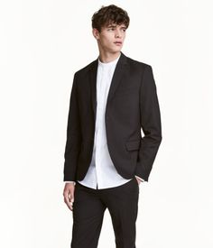 555eff0fd Black. Two-button blazer in woven fabric. Chest pocket