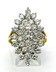 Ladies 14kt yellow gold diamond estate ring. Ring contains 33 brilliant round cut diamonds weighing a total of approximately 3ct.