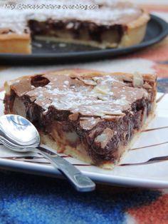 C'est Manue qui m'a tenté avec sa recette, alors hop, quand l'envie s'est fait sentir, je me suis activé en cuisine pour préparer cette douce tarte régressive, un poil encore coulante, une fine couche craquante, bref un pur délice! Pour 8 personnes Pour...