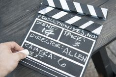 When filming a music video, it is vital to label each shot so that the editor can piece together the correct segments for the finished product. This is done with a clapper board, an instrument used to signify the beginning of a shot or a take. These boards can be purchased or created using a few pieces of wood and paint.