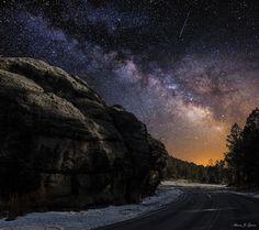 Milky Way shines bright as a meteor flies over Black Hills, South Dakota
