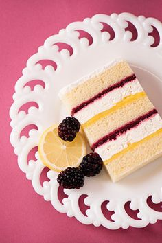 1-Meyer Lemon Cake - Luscious lemon mousse paired with tangy lemon curd layered with fresh olallieberry compote