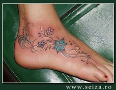 Flowers tattoo covering the foot and the ankle. This image doesn't belong to seiza.ro and is displayed for inspirational purposes only. For our collection of original tattoo designs visit the 'Original Designs for Tattoos' section.