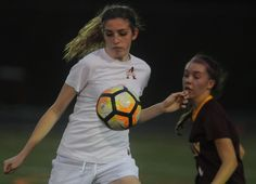Ames' forward Grace Nelson controls the ball as Ankeny's Taylor Peterson defends during the first half of the Little Cyclones' 1-0 victory on Tuesday at Ames High Stadium. Nelson scored the game's only goal. Photo by Nirmalendu Majumdar/Ames Tribune http://www.amestrib.com/sports/20170425/girls-soccer-ames-gets-sweet-shutout-victory-over-ankeny---literally