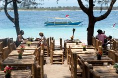 Gili Islands (Indonesia). 'One of Indonesia's greatest joys is hopping  on a fast boat from busy Bali and  arriving on one the irresistible Gili Islands. Think sugar-white sand, bathtub-warm,  turquoise waters and wonderful  beach bungalows just begging you to extend  your stay. Not to mention the coral reefs –  which haven't looked this good in years and  are teeming with sharks, rays and turtles.' http://www.lonelyplanet.com/indonesia/nusa-tenggara/gili-islands