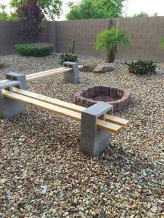 Garden Arbors To Make Your Garden More Beautiful A-unique-DIY-Cinder-Block-Bench-in-the-backyard-with-a-round-firepit-concrete-fe. A-unique-DIY-Cinder-Block-Bench-in-the-backyard-with-a-round-firepit-concrete-fe.