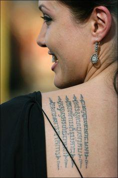 Sus tatuajes, su seña