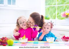 mum holding kids birthday cake - Google Search