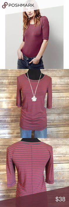 FREE PEOPLE Leader of the Pack Tee Cherry Stripe FREE PEOPLE NWOT Leader of the Pack Tee Cherry & Grey Combo stripe. Half sleeves, wide neck. Perfect new condition. Never worn or washed Free People Tops Tees - Short Sleeve