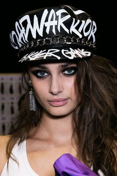 Nineties supermodels were the reference for the hair and make-up at Moschino. The hair stylist Paul Hanlon created three variations of undone, punky, bodied waves, while Tom Pecheux created strong, smoky eyes.  Imaxtree   - HarpersBAZAAR.co.uk