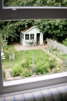 View of garden from my bedroom with the original Victorian garden shed now painted in a soft green, Kitchen Green, from Little Green Paint Co.