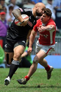 New Zealand skipper DJ Forbes smashes through a Welsh tackle