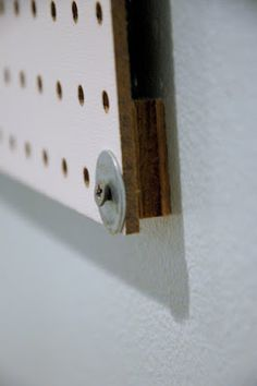 Peg Board with 1/2 inch thick 2inch x 2inch extra wood behind. nail using washer to stop nail from going thru peg board.