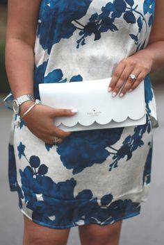 Kate Spade scallop clutch against Blue + White Floral Dress