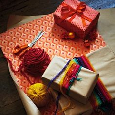 Give your presents a festive look by wrapping them with bundles of colourful string, wool or ribbon