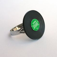 Hey, I found this really awesome Etsy listing at https://www.etsy.com/listing/96272860/miniature-vinyl-record-ring-adjustable