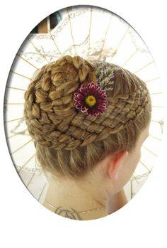 Nine-strand braid into a bun. I like how it looks like basket weaving.
