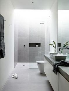 J'aime l'association de gris/blanc et la simplicité des lignes. Je prefere un lavabo integré
