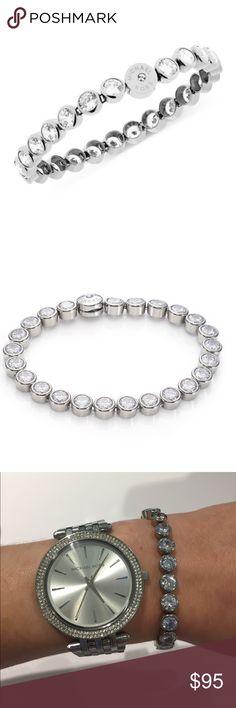 Michael Kors Tennis Bracelet 7 inch Silver Michael Kors Tennis Bracelet.  Very elegant!! Michael Kors Jewelry Bracelets