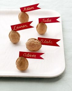 "Table seating idea. Sign saying ""Finding your seat can make all of us a little nuts"". Name plates on Purple paper, write the number for the table on the nut shell."