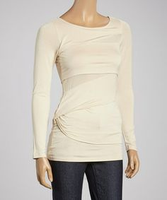 Experience sophisticated style with this classic top. Flaunting a tiered silhouette and a sweet scoop neck, it's sure to add effortless appeal to any chic ensemble.
