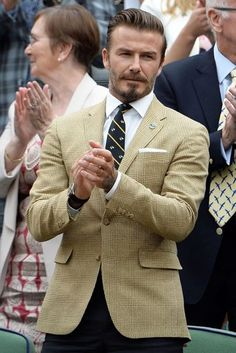 Take a look back at all of the most stylish outfits ever worn by David Beckham, from formal suits to off-duty shorts.