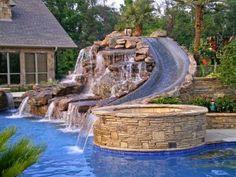 #Backyard waterslide - cool pools! | http://homechanneltv.blogspot.com/2014/05/cool-pools.html #coolpools
