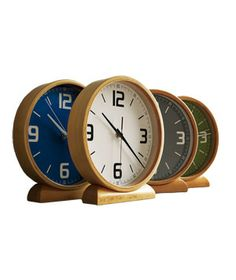 Wood Mantle Clock  Add a splash of color to your bookshelf or mantle with these footed devices.
