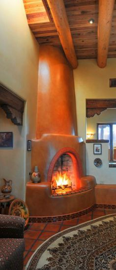 Love this orange adobe fireplace. The orange really magnifies the colors of the fire, and assures it stands out from the rest of the white walls. Southwestern Home, Southwest Decor, Southwest Style, Adobe Fireplace, New Mexico Homes, Spanish Style Homes, Spanish Revival, Spanish Colonial, Adobe House