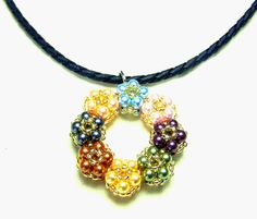 Pattern for pretty pendant Coloured Flowers.  U need:    round beads 4 mm    seed beads 2 mm