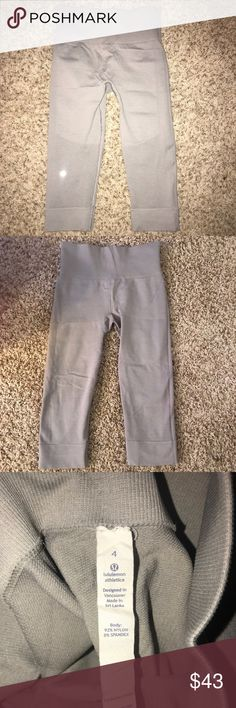 Lululemon Crops Grey silverish Lululemon Crops. Spandex and Luon material. No pilling at all. Worn but in great condition. lululemon athletica Pants Leggings