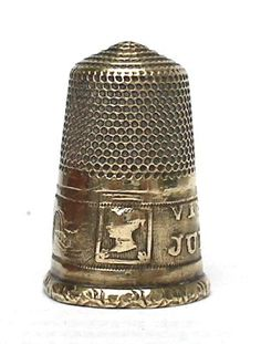 This brass thimble commemorates the visit of Queen Victoria on July 26 1843.