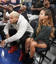 Spectating: Chris Brown and his girlfriend Karreuche Tran sat courtside at a basketball ga...