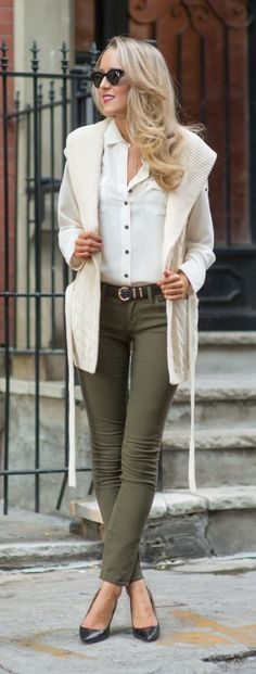 On casual Friday, wear olive pants with a white button-up and pumps.