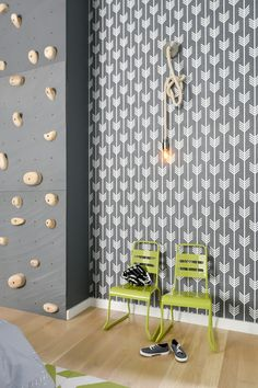 This fun kid's room from Linc Thelen features white walls with lime accents and includes a rock-climbing wall, dual bunk beds, fun graphic wallpaper and creative rope sconce lights. Illinois, Kids Bedroom Accessories, Church Conversions, Basement Furniture, Basement Stairs, Glass Front Cabinets, Herringbone Backsplash, Interior Decorating, Interior Design