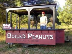 on the side of the road with a big pot of boiling peanuts