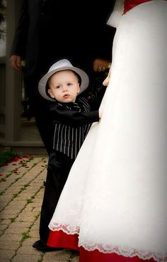 Adorable photo idea for someone's ring bearer.  (And I LOVE that pop of red under the dress!)