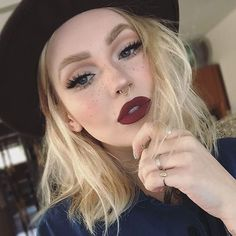 Fall makeup. Burgundy matte lips and fake freckles.