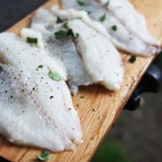 Cedar plank tilapia, perfect for fish tacos! With mango salad, red cabbage slaw and avocado creme fraiche