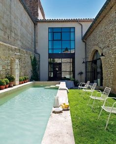 Perfect lap pool with mini lawn. This is an old oil mill house in Provence, France.