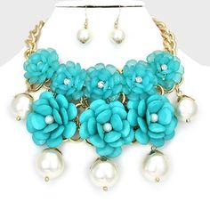 Turquoise Blue Flower Garden Gold Chain Crystal Accent Pearl Necklace Bib Collar and Earring Set. Get the lowest price on Turquoise Blue Flower Garden Gold Chain Crystal Accent Pearl Necklace Bib Collar and Earring Set and other fabulous designer clothing and accessories! Shop Tradesy now