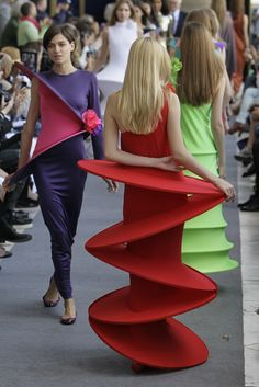 Models wear  creations by French fashion designer Pierre Cardin at the end of his Men's Spring-Summer 2013 collection, for the Paris Fashion Week, in Paris. (AP)