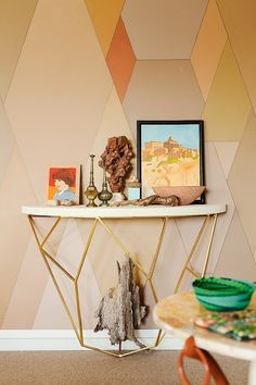 Console table against retro, patterned wallpaper