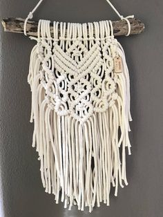 Macramé wallhanging • TEDDI • Made with white Bobbiny cord. ➰ Dimensions: Wood - 37 cm Height - 50 cm Width - 27 cm I hope this piece will put a smile on your face and brightens up your space!