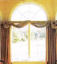 Arched windows are delight-until you try to cover them, here are some   several unique solutions for adding a beauty to any existing window treatment with the addition of this fabric   arched window shade.