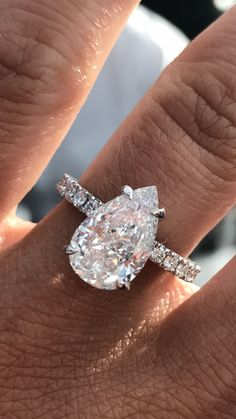 Closeup of my 3 carat excellent cut pear diamond engagement ring with scalloped eternity band QL137