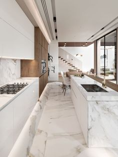 continuing with the light+natural theme. light-coloured wood carpentry. white marble flooring and kitchen.