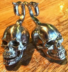 Yellow or White Brass Skull Ear Weights that have articulated jawbones by Julian Ganesha