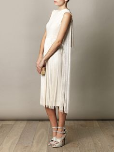 Stella McCartney fringed dress, Tabitha Simmons shoes, and Lanvin clutch