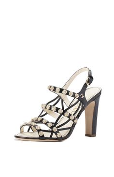 CHANEL Patent Leather Sandals with Gold Camellia Detail in Black gives me major Chanel throwback vibes with the cute gold accented details! #trendy